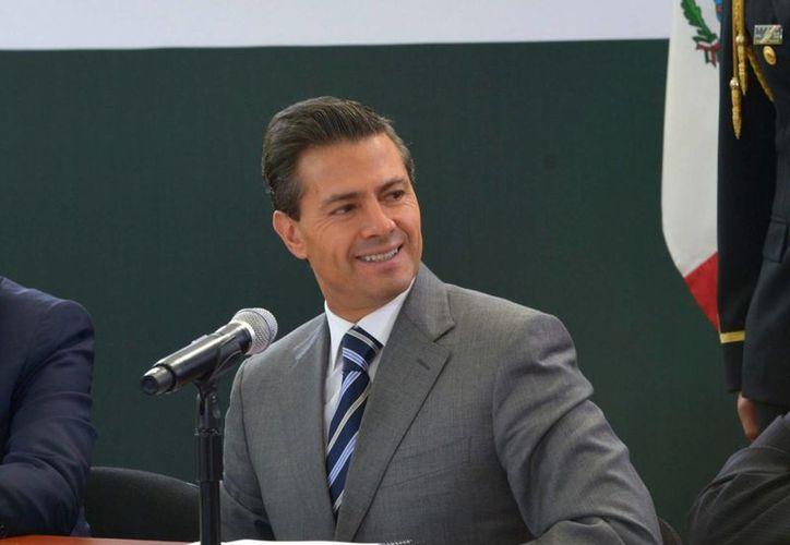 Peña Nieto asegura que la violencia en Tamaulipas se está combatiendo en equipo. (Archivo/Notimex)