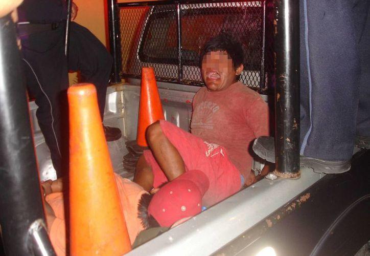 """José A.C., alias """"El Chiapas"""" y Juan C.C.R., apodado """"La Chepa"""", fueron detenidos por bailar 'eróticamente'. (Redacción/SIPSE)"""