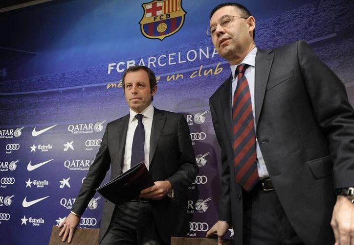 El expresidente y el actual presidente del Barcelona, Sandro Rosell (i) y Josep Maria Bartomeu, están acusados por fraude fiscal en el caso del fichaje de Neymar. (nacion.com)