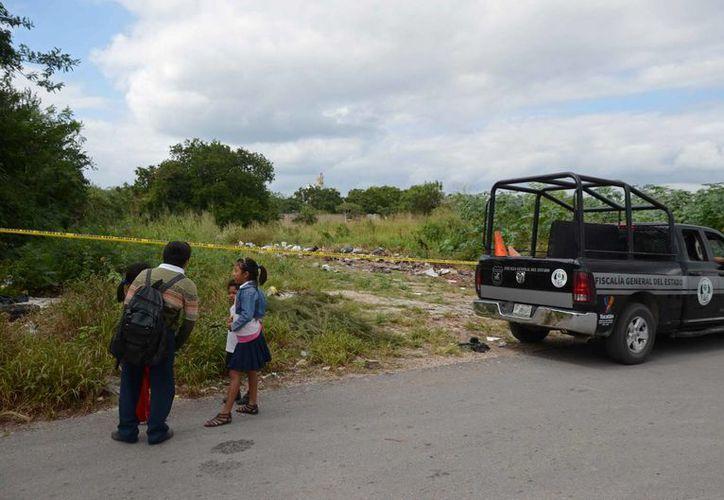 Tras el asalto y crimen en contra de Luis Luna Guarneros, sus victimarios sacaron el cuerpo de su casa en el centro de Mérida y lo arrojaron en un terreno baldío en San Marcos Nocoh. (SIPSE)