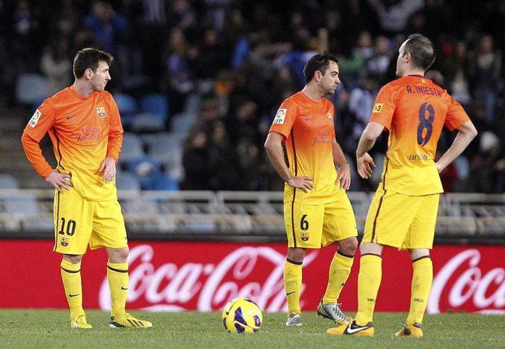 Xavi cree que a pesar de las lesiones, el Madrid dará pelea. (Foto: EFE)