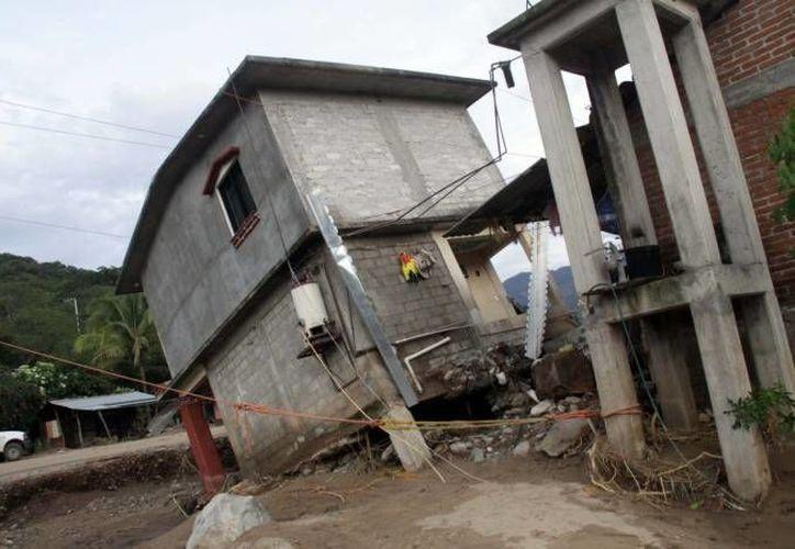 Numerosos municipios de México viven en estado de emergencia desde hace varios días tras el paso de 'Ingrid' y 'Manuel'. (Notimex/Foto de archivo)