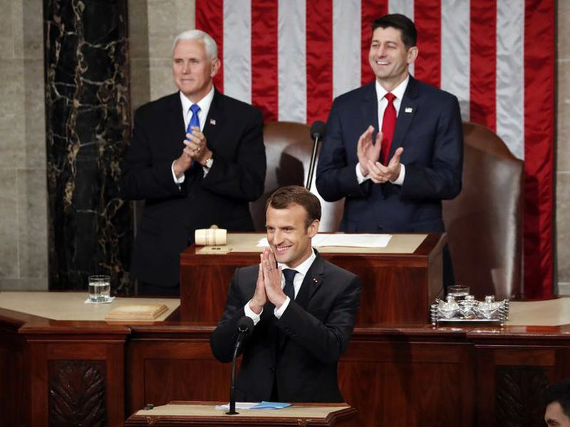 French President Emmanuel Macron gestures as he is introduced before speaking to a joint meeting of Congress on Capitol Hill in Washington. (AP)