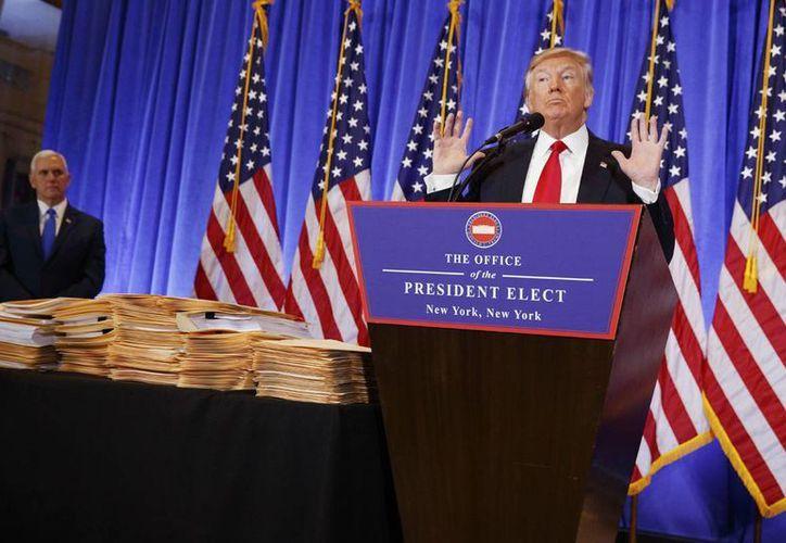 El expresidente Vicente Fox pidió no temer a Donald Trump porque dijo, es un farol. Imagen del presidente electo de EU, durante su conferencia de prensa. (AP Photo/Evan Vucci)