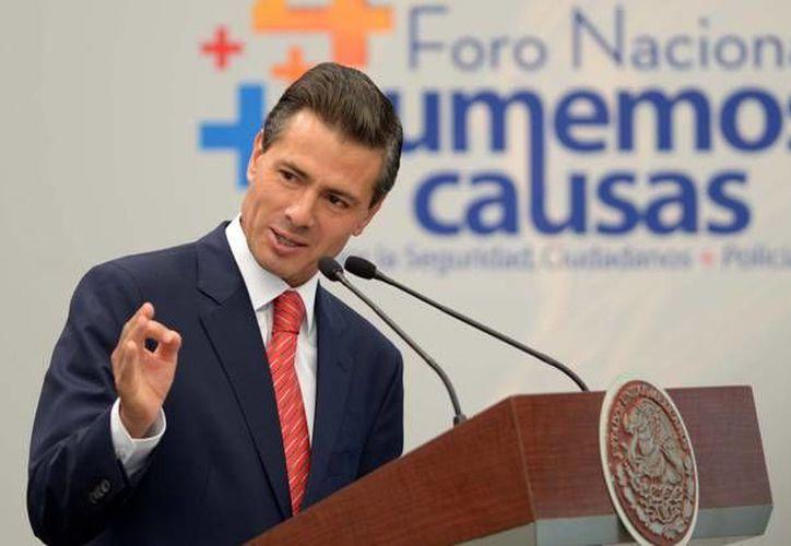 El presidente Enrique Peña Nieto durante su participación este lunes en el Cuarto Foro Nacional Sumemos Causas. Por la Seguridad, Ciudadanos + Policías, evento realizado en el Alcázar del Castillo de Chapultepec. (Presidencia)