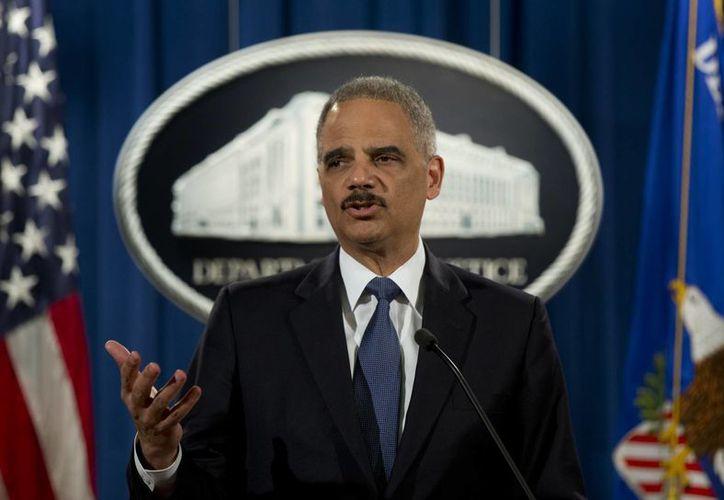 Eric Holder aseguró que la situación de la Policía de Ferguson es 'insostenible'. (AP)