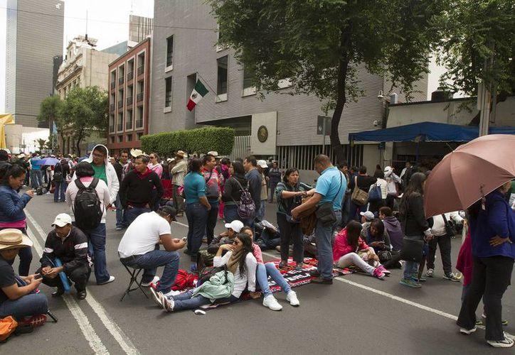 Panorámica de un mitin de la CNTE a las afueras de las instalaciones del edificio de la Secretaría de Gobernación en el DF. (Notimex/Foto de archivo)