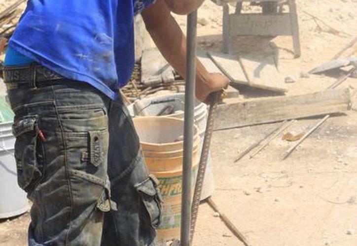 La industria de la construcción pertenece al sector secundario de las actividades económicas. (Archivo/SIPSE)
