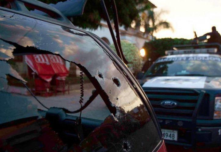 A pesar de los balazos y el granadazo, sólo hubo un herido. (Daniel Cruz/MILENIO)