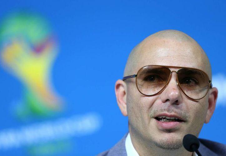 El rapero estadounidense Pitbull, uno de los intérpretes de la canción oficial del Mundial 'We Are One (Ole Ola)', participa en una rueda de prensa en el estadio Arena Corinthians. (EFE)