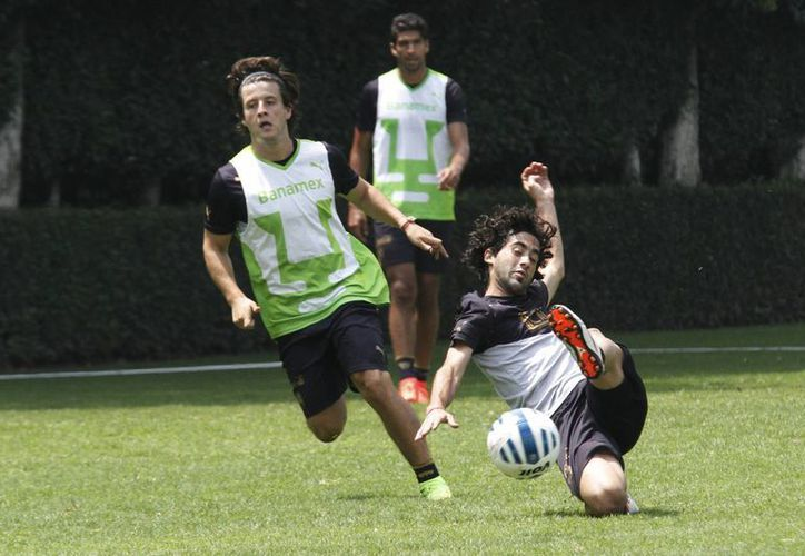 Pumas durante un entrenamiento previo al arranque del Torneo Apertura 2014. (Notimex)