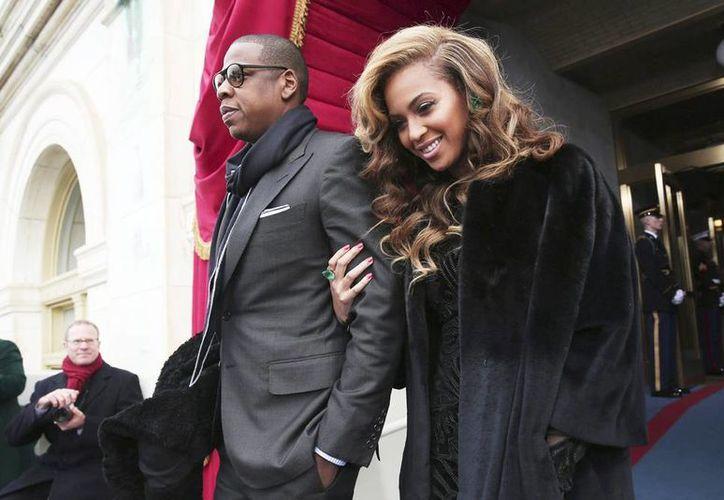 En la imagen, los artistas estadounidenses Jay-Z (izquierda) y Beyoncé en un evento el año pasado. (EFE/Archivo)