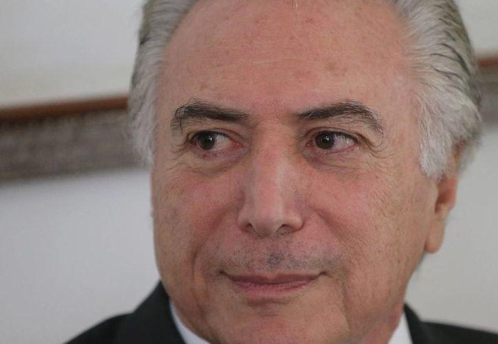 El nuevo Gobierno de Michel Temer tiene el reto de recomponer la base oficialista en el Congreso. (Agencias)