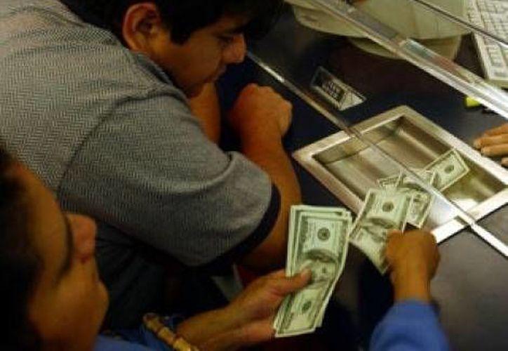En mayo, el promedio por remesa fue de 286.81 dólares. (Archivo/SIPSE)