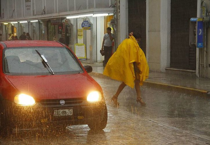 Las lluvias fuertes se prolongarán viernes, sábado y domingo en Yucatán, según pronósticos de la Conagua. (Juan Albornoz/SIPSE)