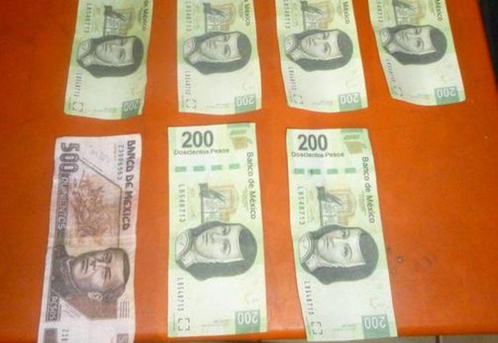 Una mujer fue detenida tras intentar pagar con dinero falso, le decomisaron $2 mil 500. (Redacción/SIPSE)