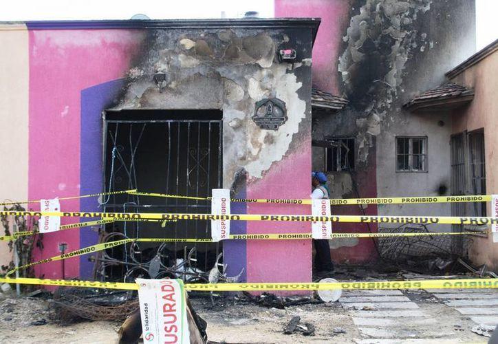 El 15 de diciembre del año pasado, siete tanques de gas explotaron al momento de practicarle trasiego en el interior de una casa del fraccionamiento Misión del Carmen. (Octavio Martínez/SIPSE)