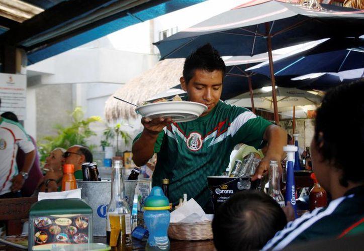 Los restaurantes de Playa del Carmen estiman que durante lo que resta del Mundial de Fútbol su ocupación será de hasta 75%.  (Octavio Martínez/SIPSE)