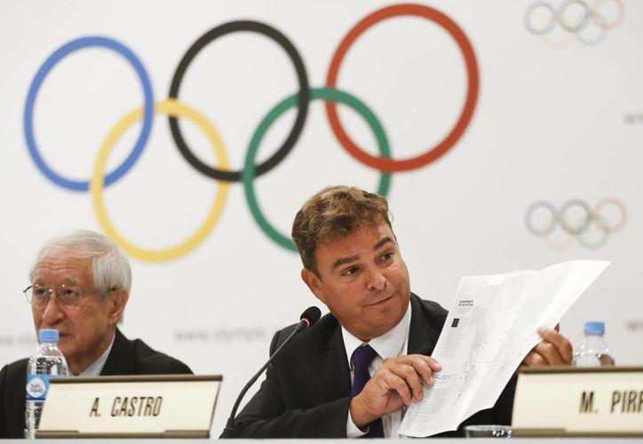 Antonio Castro (d) hijo de Fidel Castro, lucha en Argentina por devolver al beisbol/softbol al programa olímpico. (Agencias)