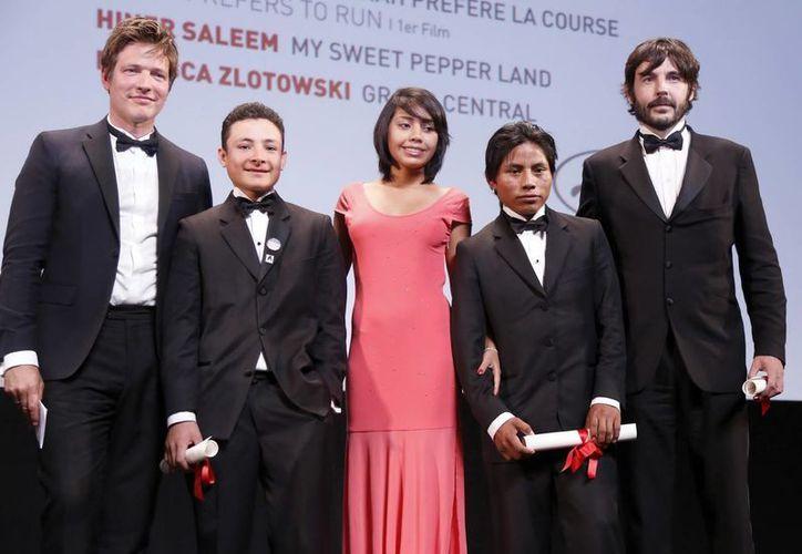 Los actores Brandon Lopez, Karen Martinez, Rodolfo Dominguez y el director Diego Quemada-Diez (Efe).