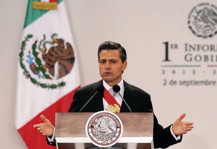 En su primer informe, Peña Nieto dijo que construyó los cimientos para cumplir sus compromisos de campaña. (Archivo/SIPSE)