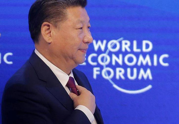 El presidente chino Xi Jinping subrayó que 'China mantendrá sus puertas abiertas'. (AP/Michel Euler)