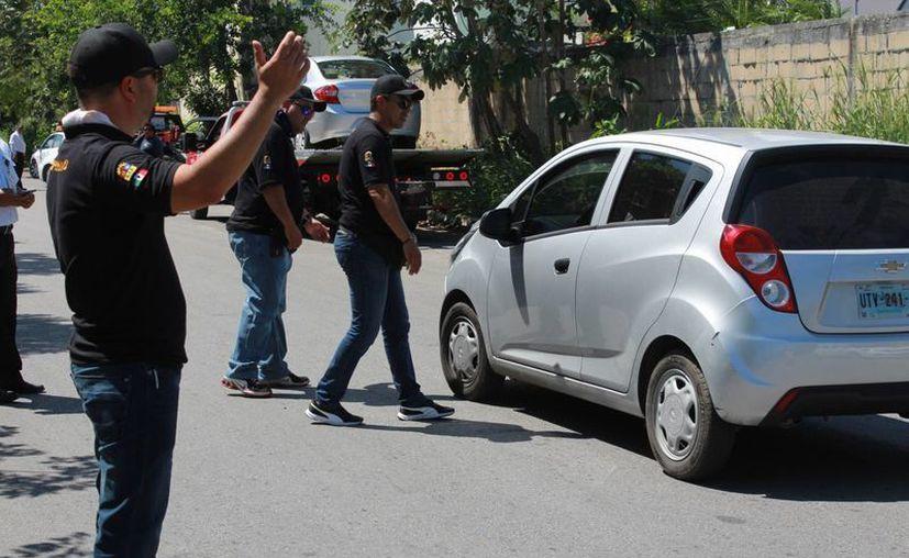 Los operativos de revisión que realiza Sintra para ubicar a choferes de Uber son inconstitucionales según abogados. (Luis Soto/SIPSE)