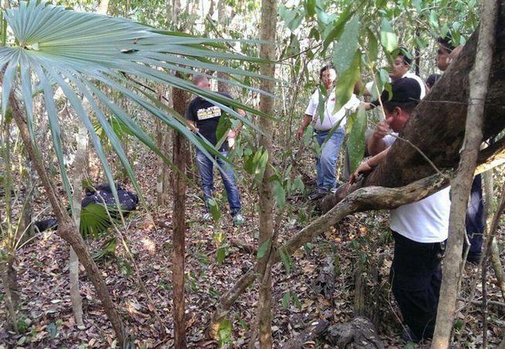 El estadounidense extraviado en un cenote fue hallado sin vida en el monte aún con el traje de buzo. (Redacción/SIPSE)