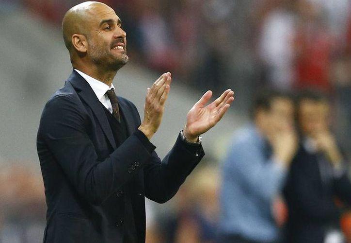 El entrenador español Josep Guardiola dejará la banca del Bayer Munich al final de la campaña. Ante esto, las sospechas sobre su futuro no se han hecho esperar, por lo que la prensa de Alemania afirma que su siguiente equipo pertenece a la Liga Premier. (Archivo AP)