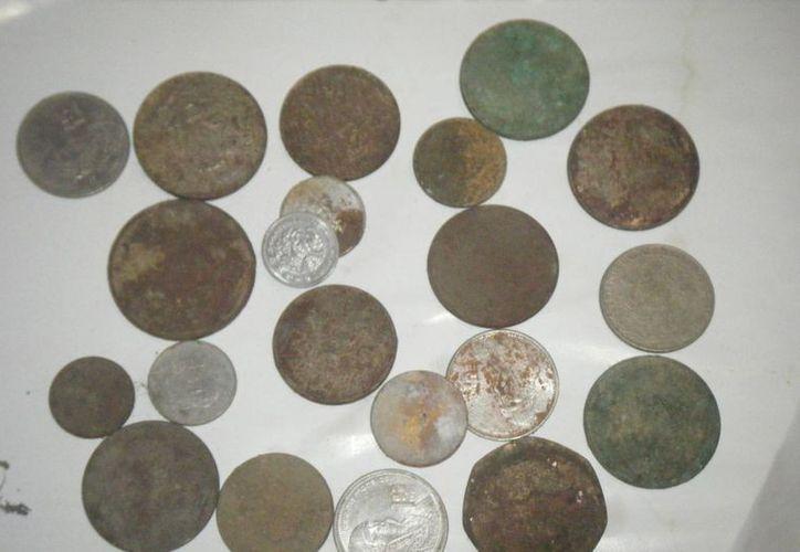 Miles de monedas de oro y plata aún se encuentran enterradas en decenas o cientos de casas y terrenos de Yucatán. (buscadores-tesoros.com/Foto de contexto)