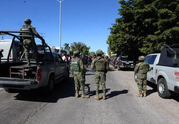 Tras el enfrentamiento, los militares aseguraron cuatro armas largas, dos cortas, cartucho útiles de diferentes calibres y fornituras. (Foto de contexto/Notimex)
