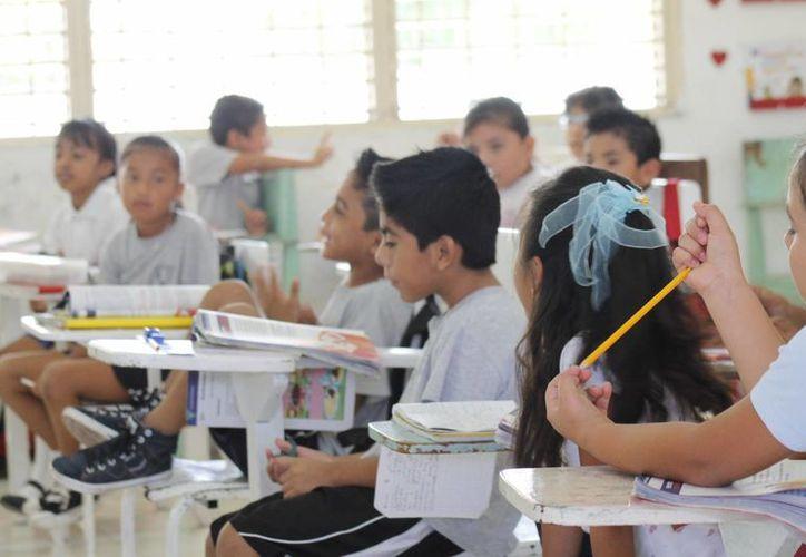 Del 50% de escuelas que estuvieron sin clases en el segundo paro, el 70% ha logrado ponerse al día con los contenidos temáticos. (Israel Leal/SIPSE)