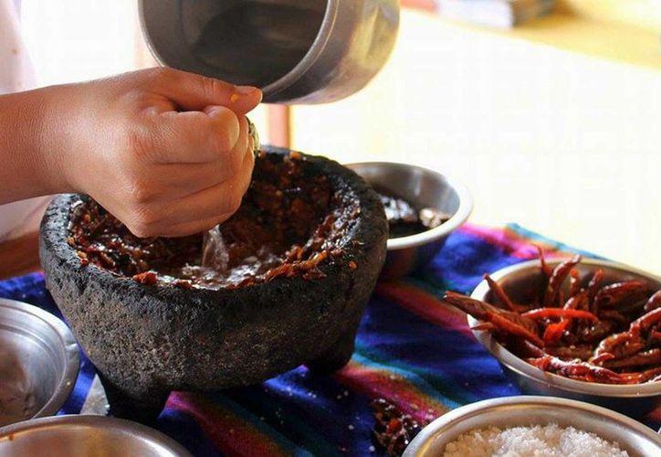 La gastronomía mexicana fue declarada Patrimonio Inmaterial por la Unesco, punto que el gobierno federal aprovechará para promover y fortalecer el sector. (Archivo/Notimex)