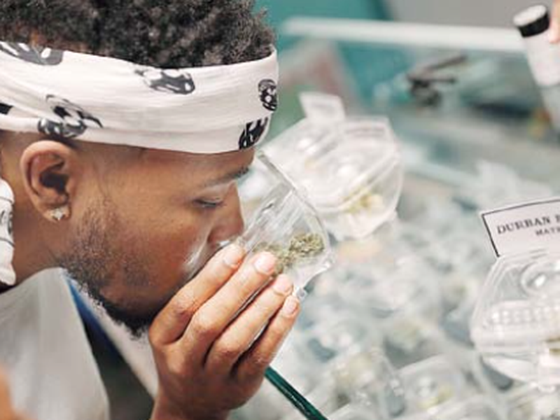 Zechaiah Jacobs shops for marijuana at the Exhale Nevada dispensary in las Vegas. (AP)