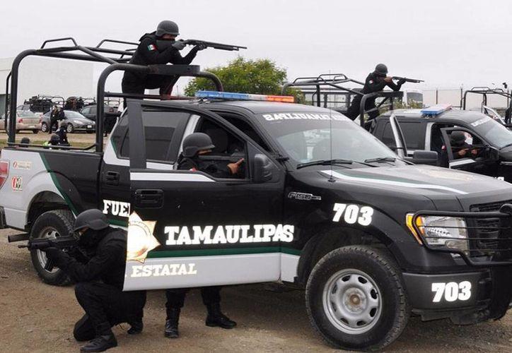 Los policías repelieron el ataque y solicitaron apoyo a las demás corporaciones integrantes del Grupo de Coordinación Tamaulipas. Imagen de contexto de los policías estatales de Fuerza Tamaulipas. (tamaulipas.gob.mx)