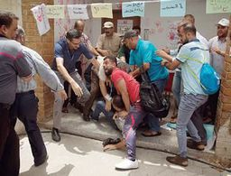 Hundreds of Gazans protest UN agency layoffs