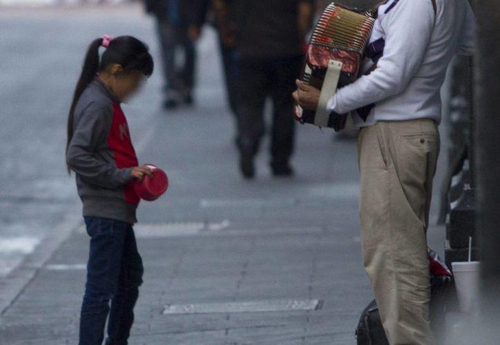 De acuerdo con el Inegi, el número de niños que trabaja ha disminuido en Yucatán. La imagen es de contexto. (NTX/Archivo)
