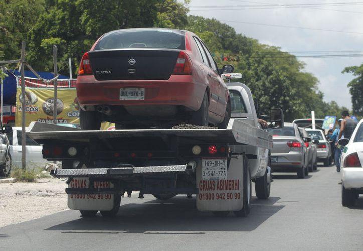 La liberación de un vehículo de Uber oscila entre 80 y 90 mil pesos por cada uno. (Foto Jesús Tijerina)