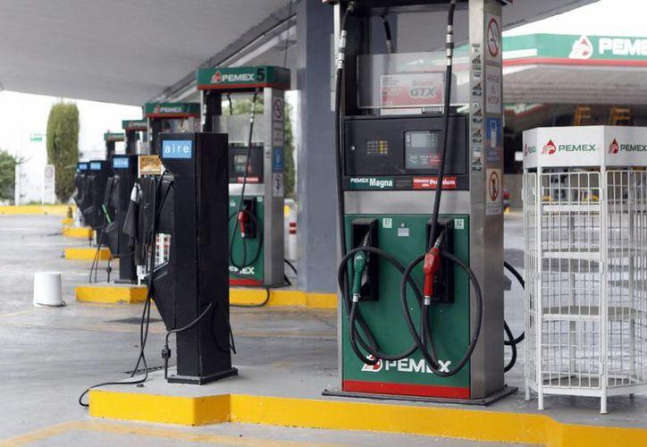 Bajo el nombre de Car-go, 150 empresarios gasolineros de Puebla, Tlaxcala, Edomex, Hidalgo y D.F., entraran al mercado para competir con Pemex. En la imagen una franquicia de Petróleos Mexicanos. (Archivo/Notimex)