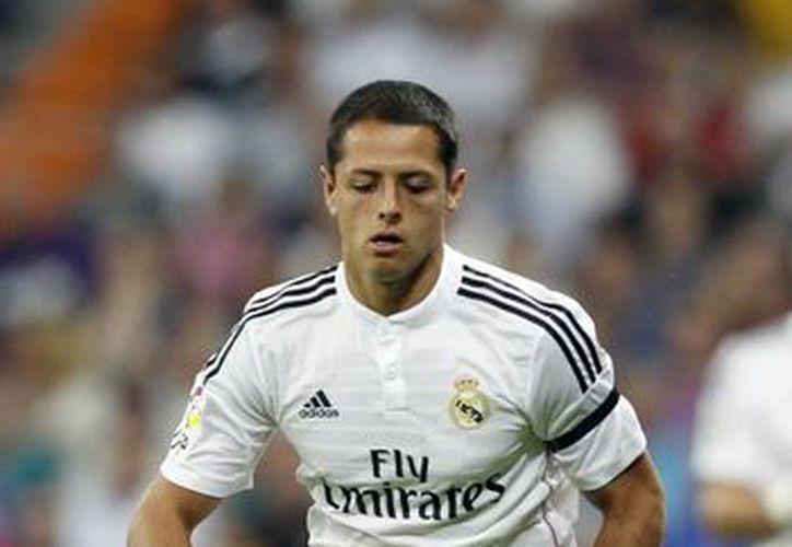'Chicharito' Hernández marcó sus dos primeros goles con Real Madrid, pero como visitante. Este martes podría anotar en el estadio Santiago Bernabeu. (EFE)