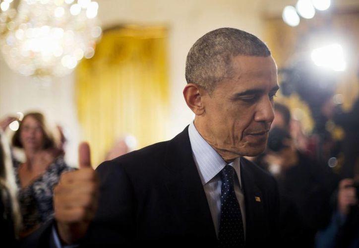 El presidente Barack Obama busca ampliar  el programa de suspensión de deportaciones que lanzó en el 2012. (Agencias)