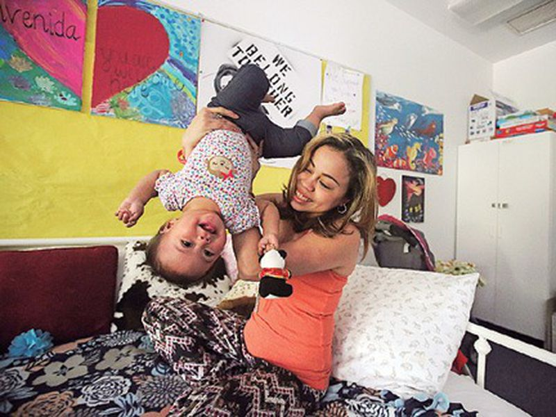 Vicky Chavez plays with her daughter Issabella in their room within the walls of the First Unitarian Church, in Salt Lake City.