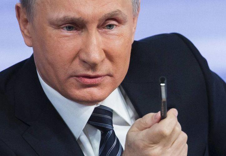 El presidente de Rusia, Vladimir Putin, dialogó con su homólogo estadounidense sobre las condiciones del alto al fuego para Siria anunciado este lunes. (AP)