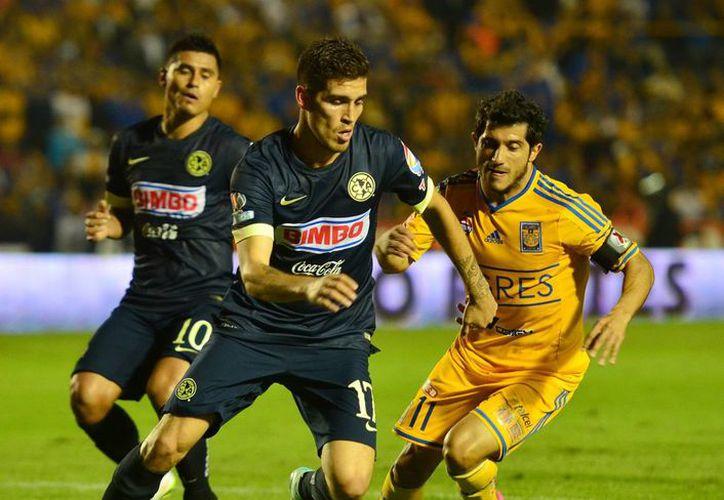 América y Tigres fueron dos de los equipos más goleadores del torneo Apertura 2014, pero en liguilla apenas han metido 7 goles entre ambos, en seis partidos en total. (Notimex)