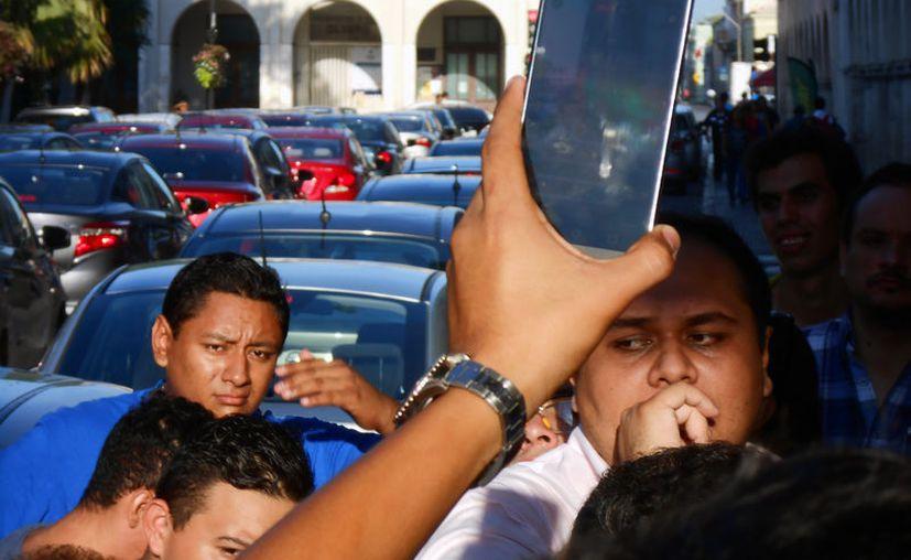 En los próximos días, la SCJN decidirá sobre una controversia de un grupo de diputados de Yucatán, en la que cuestionan algunos artículos de la Ley del Transporte. El proyecto va a favor de Uber. La imagen, de una protesta de Uber, en Mérida, está utilizada con fines ilustrativos. (SIPSE)