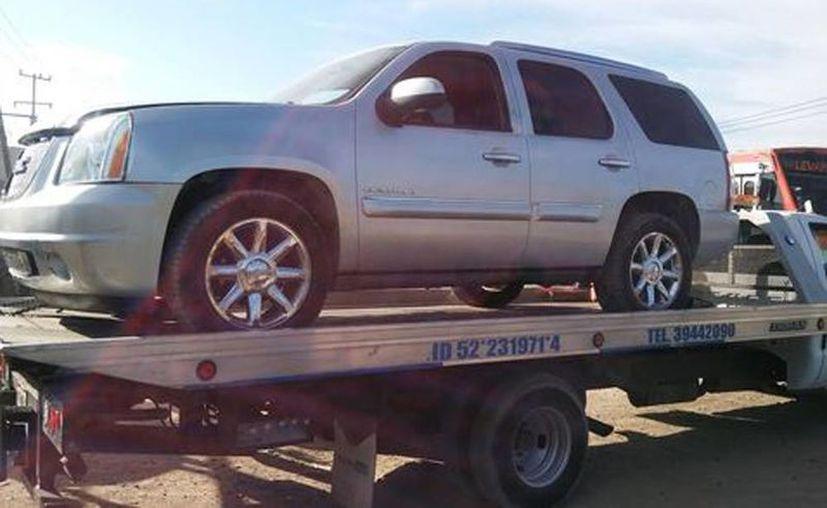 Una de las camionetas aseguradas en Tlaquepaque, en donde encontraron los cadáveres de seis personas. (Milenio)