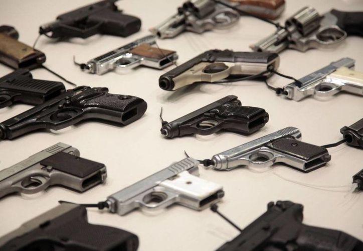 Especialistas aseguran que el 80 por ciento de los homicidios en el país son cometidos con armas de fuego. (contexto/laopinion.com)