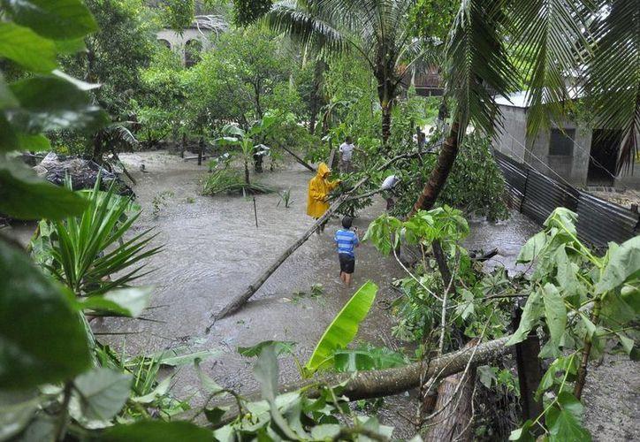 En lo que va de la temporada 2016, se han desarrollado cinco tormentas en el Atlántico. Imagen de contexto de una comunidad afectada tras el paso de un huracán. (Archivo/Notimex)