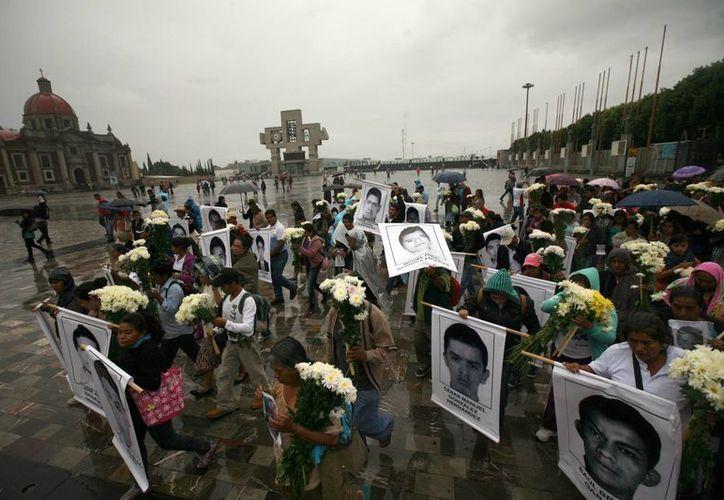 El Estado Mexicano solicitó la intervención de la Comisión Interamericana de Derechos Humanos para atender el caso de los 43 estudiantes desaparecidos en Iguala hace ya casi un mes. (AP)
