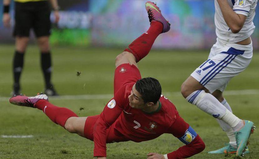 Portugal y Cristiano Ronaldo están en tercer lugar de su grupo y a cuatro puntos del líder Rusia. (Agencias)